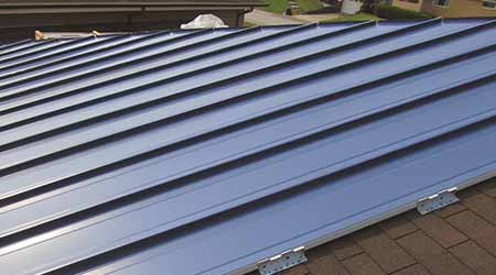 Metal System Recovers Damaged But Functional Shingled Roofs: Tremco
