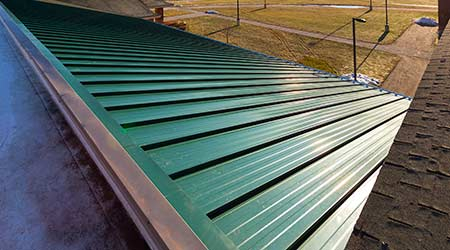 Metal Roof System Helps Prevent Wind Uplift: The Garland Co. Inc.