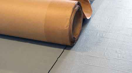 Roofing Membrane Creates Tight Seal Between Low-Slope System and Building: Mule-Hide Products Co.