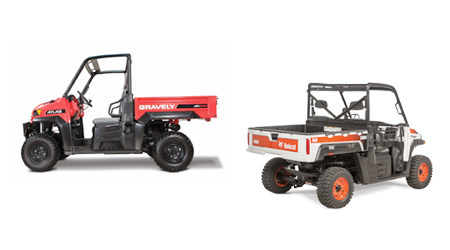 two-seater utility vehicles in orange and white, and red