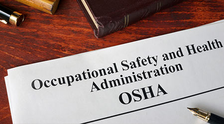 Occupational Safety and Health Administration OSHA and a book