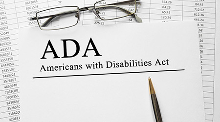 Paper with ADA on a table