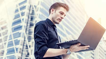 businessman use of the notebook computer outdoors