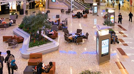 People, shops and restaurants in the Hartsfield-Jackson International Airport
