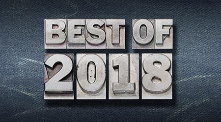 best of 2018 phrase made from metallic letterpress on dark jeans background