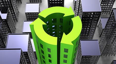 Sustainability with buildings in the icon of recycling
