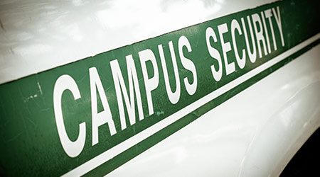 Retro Filtered Campus Security Sign On The Side Of A University Vehicle
