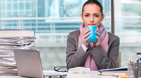 cold woman in office