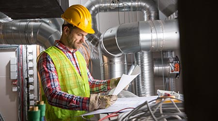 Worker making final touches to HVAC system