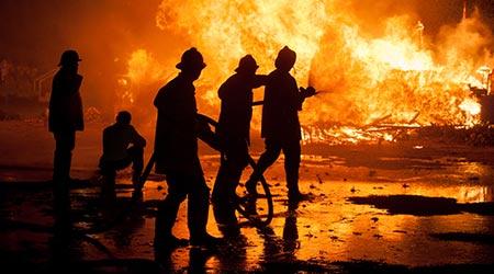 Firemen fighting a raging fire