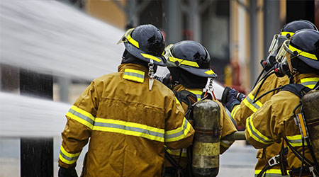 Firefighters hose spray