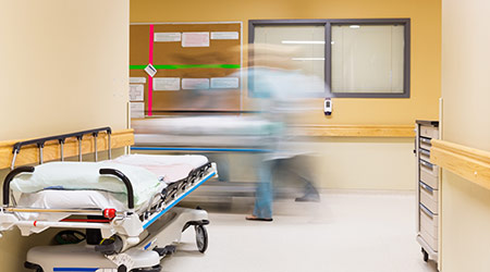 nurses with stretcher walking in hospital corridor
