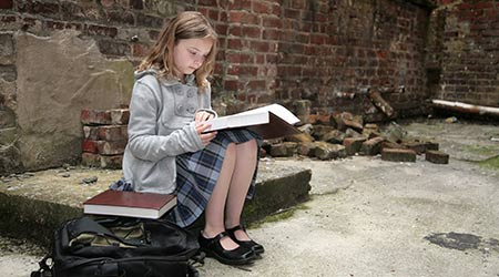 female student studying in old school