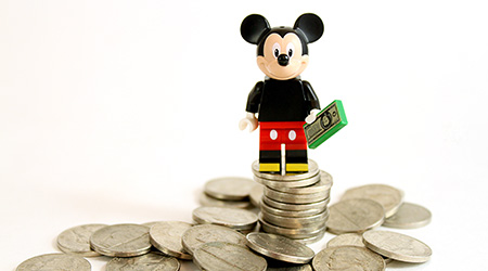 LEGO minifigure Mickey Mouse on top of a pile of money