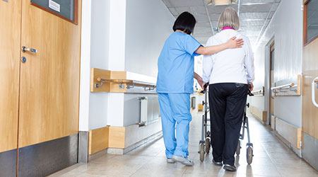 Nurse with patient walking down the hall