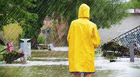 Woman standing in a flooded park