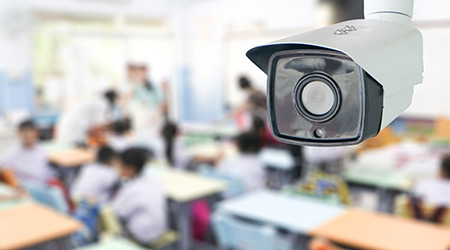 CCTV security monitoring student in classroom at school