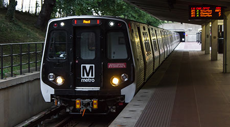 Metro train pulls into the station at White Flint metro station at Rockville/North Bethesda Maryland on July 4th 2017