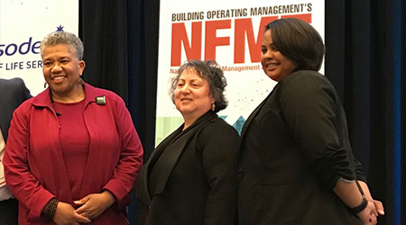 From the left, Telva McGruder, Audrey Schultz, and Celina Wilder on the stage at NFMT.