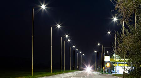 night empty road with modern LED street lights, entrance to a sm