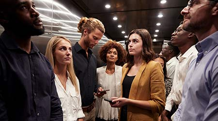 Crowd of people in an elevator.