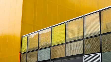 Yellow windows on a yellow building facade