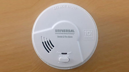University Security Instruments round white smoke detector