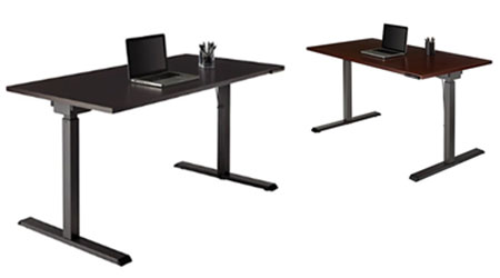 Two adjustable height desks with laptops on top.