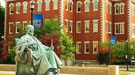 A statue of James Kennedy Patterson sits on the campus of the University of Kentucky.