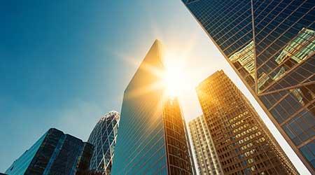 high rise buildingsand the sun