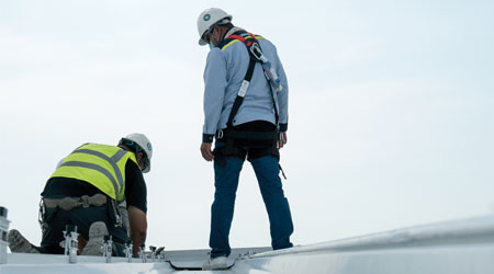 Technicians inspecting roof