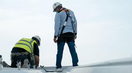 Technicians inspecting roof