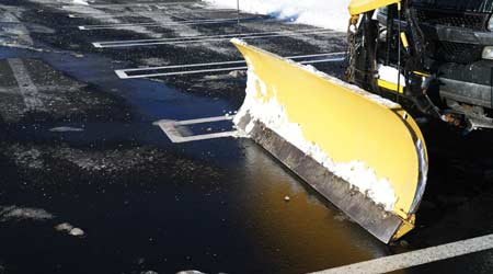 Snow plow on parking lot