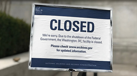 Sign at National Archives Museum informs public that due to government shutdown facility is closed