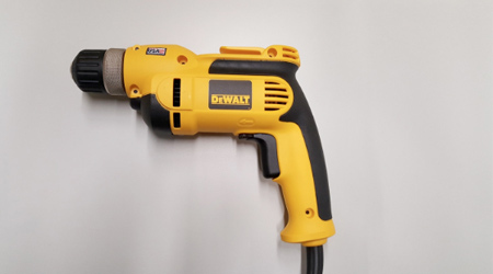 Yellow corded DeWALT drill with black accents.
