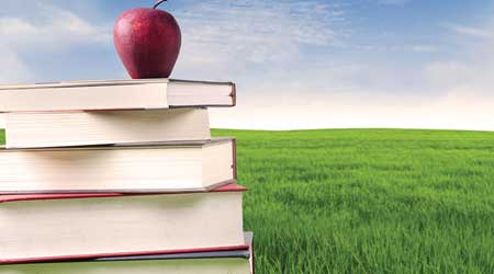 apple and book as symbol for green schools