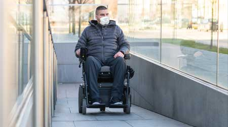 Man in a wheelchair with mask