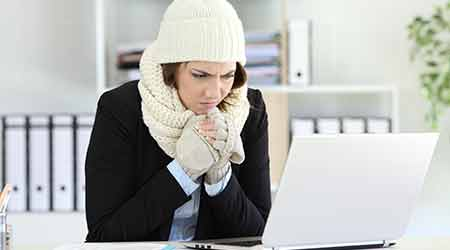 woman cold in office