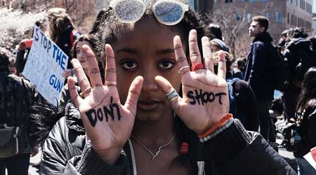 Student Protester with Don't Shoot Written on her palms