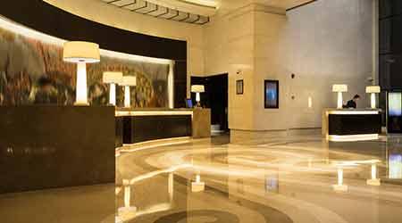 Empty hotel lobby interior with reception desk