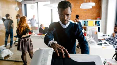 Office worker using laser printer.