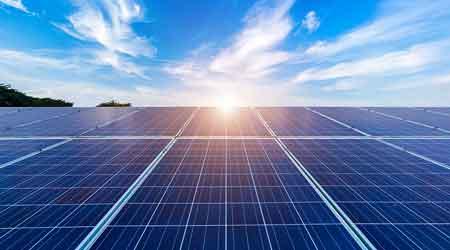 solar panels with sun shining