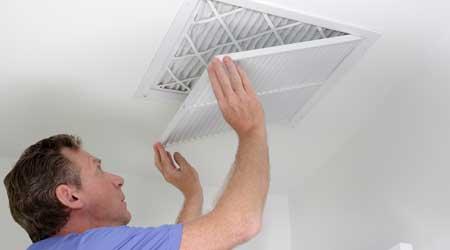 guy changing air filter
