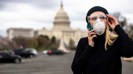 Woman with mask at U.S. Capitol