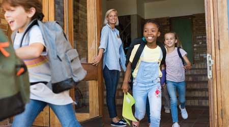 Children at K-12 school doors