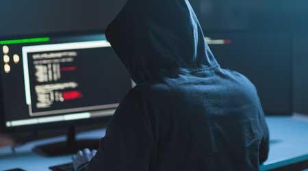 Hacker at a computer screen