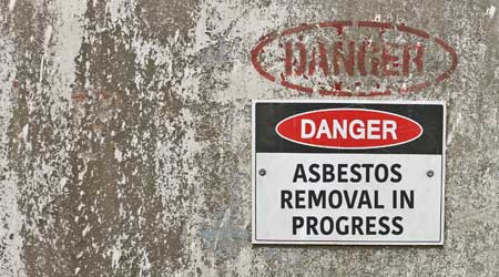 """red, black and white """"Danger, Asbestos Removal in Progress"""" warning sign"""