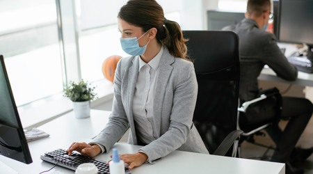 Office worker with mask