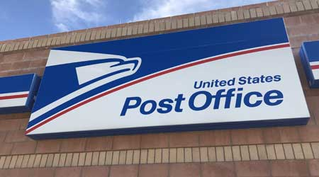 Exterior signage on the front of U.S. Post Office building